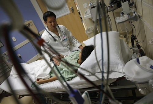 Patient Navarro speaks with Doctor Yeh in the Emergency Room at OSF Saint Francis Medical Center in Peoria