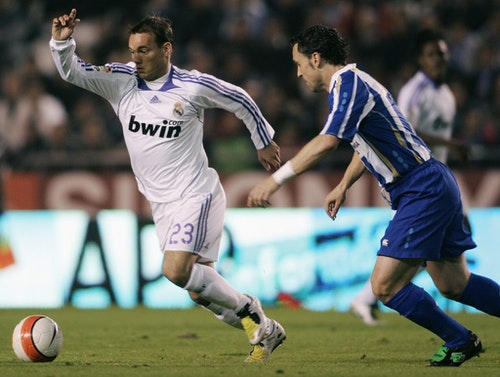 Deportivo Coruna's Sergio Garcia runs for the ball with Real Madrid's Wesley Sneider during their Spanish first division soccer match in Coruna