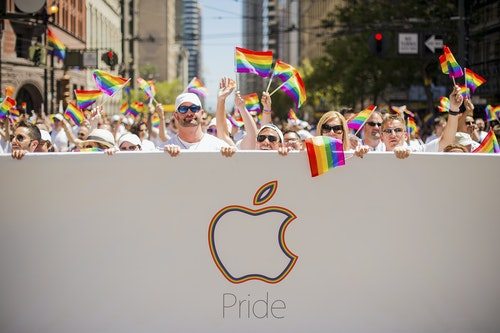 Apple employees carry rainbow flags as they march in the San Francisco Gay Pride Festival in California