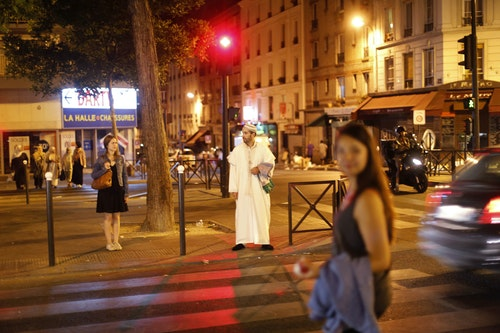 Lahcen waits to cross a street in Paris