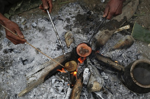 Naga men cook raw opium as they prepare it for smoking at a hunter's base in an opium field during a hunting trip between Donhe and Lahe township in the Naga Self-Administered Zone
