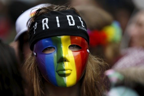 A participant wears a rainbow mask as she attends the Belgian LGBT Pride Parade in Brussels