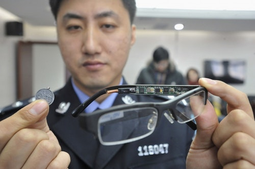The police displaying high-tech cheating devices. Photo Credit: Reuters