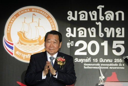 Dhanin, chairman of Thailand's largest agribusiness group Charoen Pokphand Foods, gestures upon arrival at a Thailand-China Business Council seminar in Bangkok