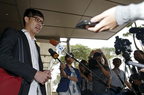 Blogger Roy Ngerng speaks to the media after attending a damages hearing in a defamation case by Singapore's Prime Minister Lee Hsien Loong at the Supreme Court in Singapore