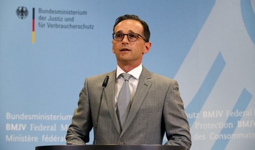 Maas gives a statement to the media at the Ministry of Justice in Berlin