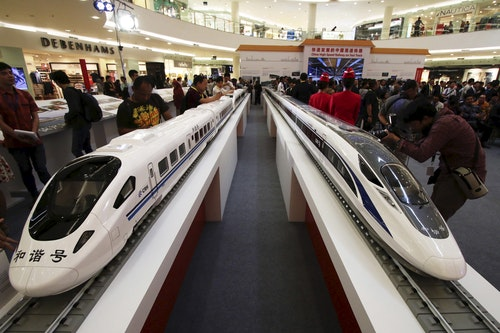 Models of high speed trains are seen during the China High Speed Railway on Fast Track exhibition in Jakarta
