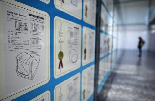 A visitor looks at Apple patents displayed at the World Intellectual Property Organization headquarters in Geneva