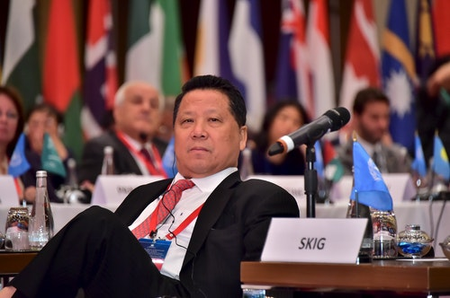 David Ng, Chairman of the Sun Kian IP Group Foundation sits at the High-level Multi-Stakeholder Strategy Forum in Macau