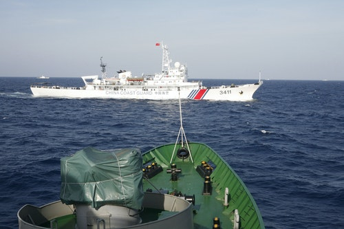 A ship of Chinese Coast Guard is seen near a ship of Vietnam Marine Guard in the South China Sea