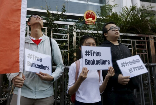 Members of student group Scholarism hold up placards during a protest about the disappearances of booksellers outside China's liaison office in Hong Kong,. Photo Credit: Reuters/達誌影像