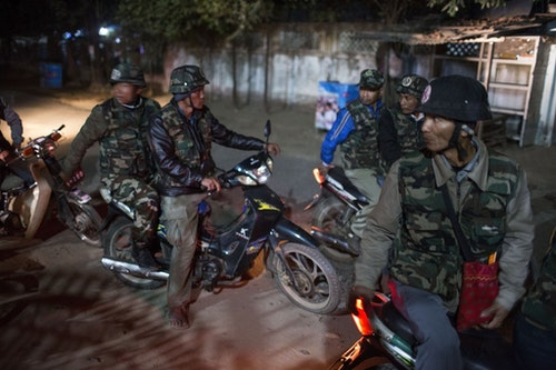 MYITKYINA, BURMA - JANUARY 26: A team of Pat Jasan members on motorbikes patrols the streets looking for drug users on January 26, 2016 in Myitkyina, Burma. Pat Jasan is a Christian anti-drug group in Kachin State claiming over 100,000 members. Dissatisfied with the government's response towards widespread heroin use and poppy growing, the religious organization has taken matters into their own hands, organizing patrols, raiding houses, detaining drug dealers and users, and clearing poppy fields. Their brand of vigilante justice has been labeled extreme with some chapters accused of publicly beating those involved in the drug trade. (Photo by Taylor Weidman/Getty Images)