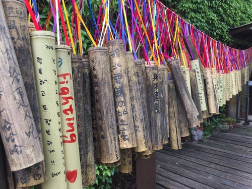 Walkways and canopies of bamboo tokens near Ching Tung station encapsulates people's wishes. Photo Credit: Jenny Peng