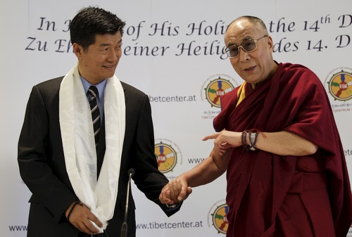 File photo of Tibet's exiled spiritual leader the Dalai Lama and Lobsang Sangay, Prime Minister of the Tibetan government-in-exile, arriving in Vienna