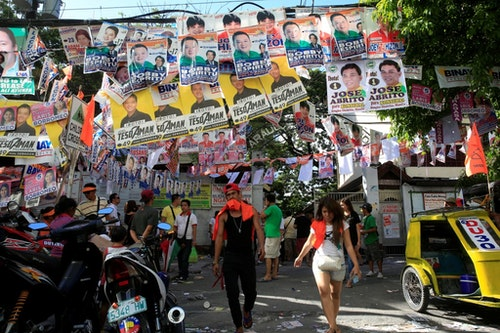 Electoral campaign materials are displayed in front of a school polling precinct during the national elections at Manila in the Philippines May 9, 2016. REUTERS/Romeo Ranoco - RTX2DG43