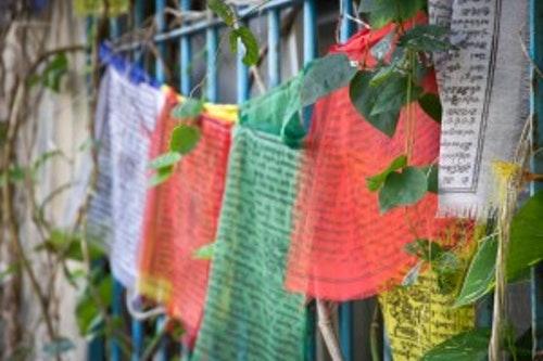 prayer flags outside Tea Sage Hut in Miaoli