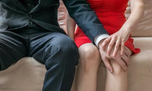 性騷擾 Sexual harassment at workplace. Manager is touching knee of his secretary.