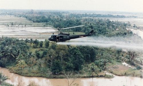US-Huey-helicopter-spraying-Agent-Orange