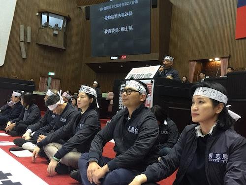 KMT legislators Legislative Yuan workers uniforms