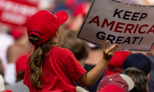 Manchester, NH - August 15, 2019: Young girl on shoulders of her father listens President Donald Trump speech at MAGA rally at Southern New Hampshire University