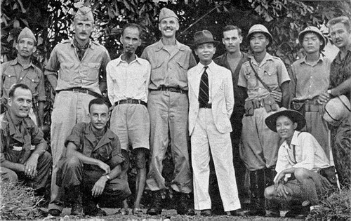 Ho_Chi_Minh_(third_from_left_standing)_a