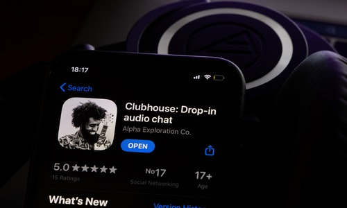Amsterdam, Netherlands - 01.19.2021: Clubhouse application view on the smartphone, controversy 2021 that hides behind the Social app. Clubhouse drop in audio chat application view on the smartphone